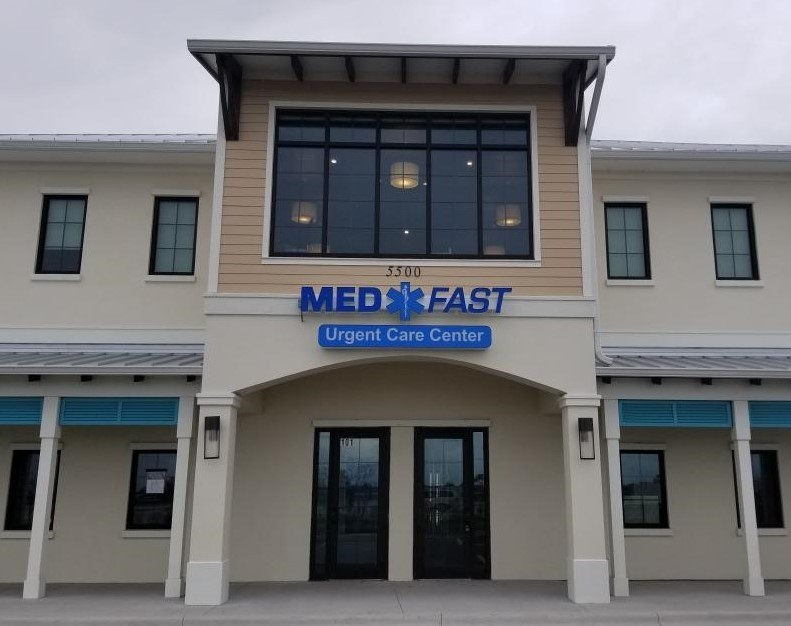 Two story building with med fast care on the front